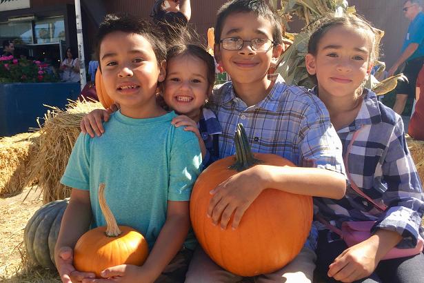 Harvest Festival Kids with Pumpkin