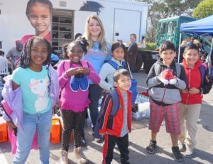 Day of Giving kids with shoes