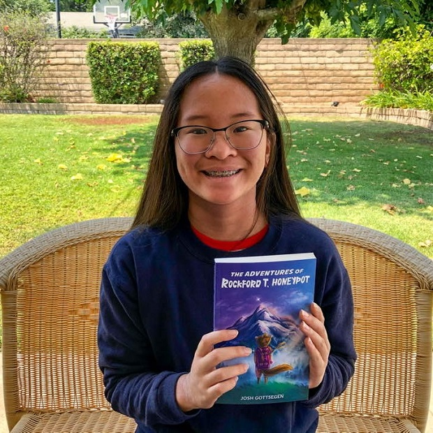 Adventures of Rockford T. Honeypot_holding book 2
