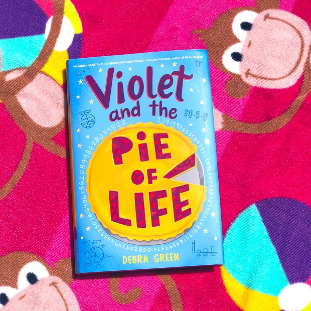 Violet and the Pie of Life - book on beach blanket